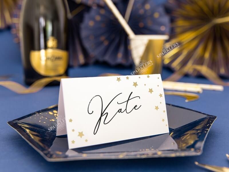 Marque place en papier blanc avec des étoiles or (lot de 10)