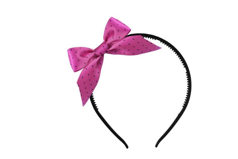 Serre tête noeud papillon rose à pois noirs